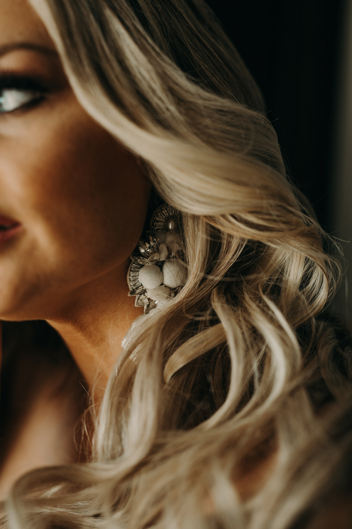 The bride was rocking statement rhinestone and lace earrings