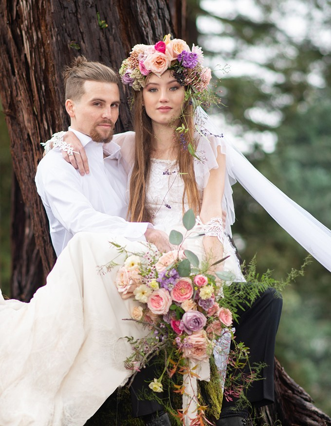 The bride was wearing a lace sheath wedding dress with sheer cap sleeves and a high neckline