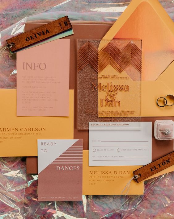 a 70s inspired wedding invitation suite in brown and marigold, with touches of leather