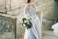 03 a beautiful light grey wedding dress with an embroidered illusion bodice, long sleeves and a layered skirt plus a train