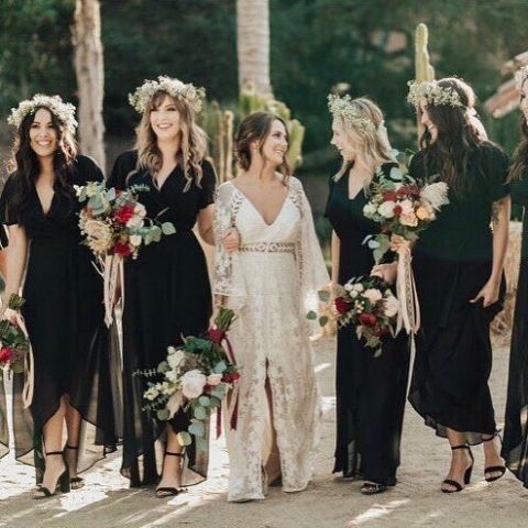 black midi dresses with high low skirts and floral crowns for a boho wedding will work for most of weddings