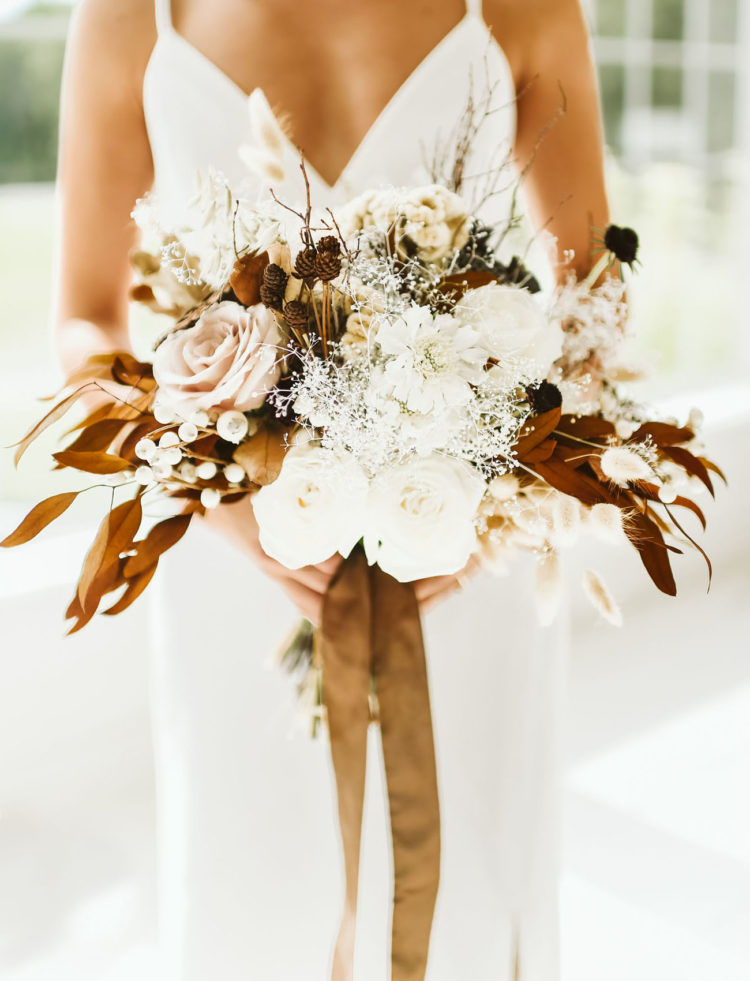 The wedding bouquet was full of dried blooms and herbs plus fresh blush and white ones