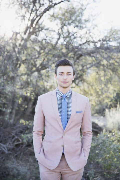 a blush suit, a printed shirt and a blue polka dot tie is a whimsy groom's look for spring or summer