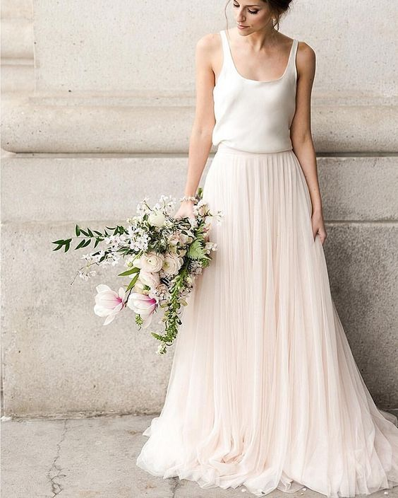 a casual bridal separte with a white silk top and a plush layered maxi skirt for delicate bridal style