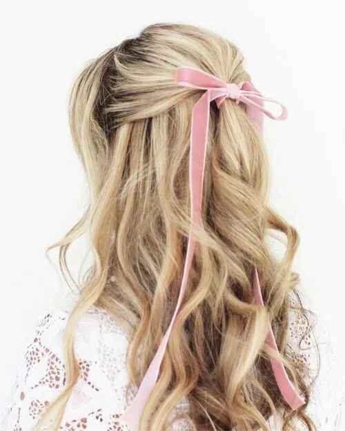 a wavy half updo with a pink velvet ribbon bow for an accent is a very girlish and sweet idea for a bride