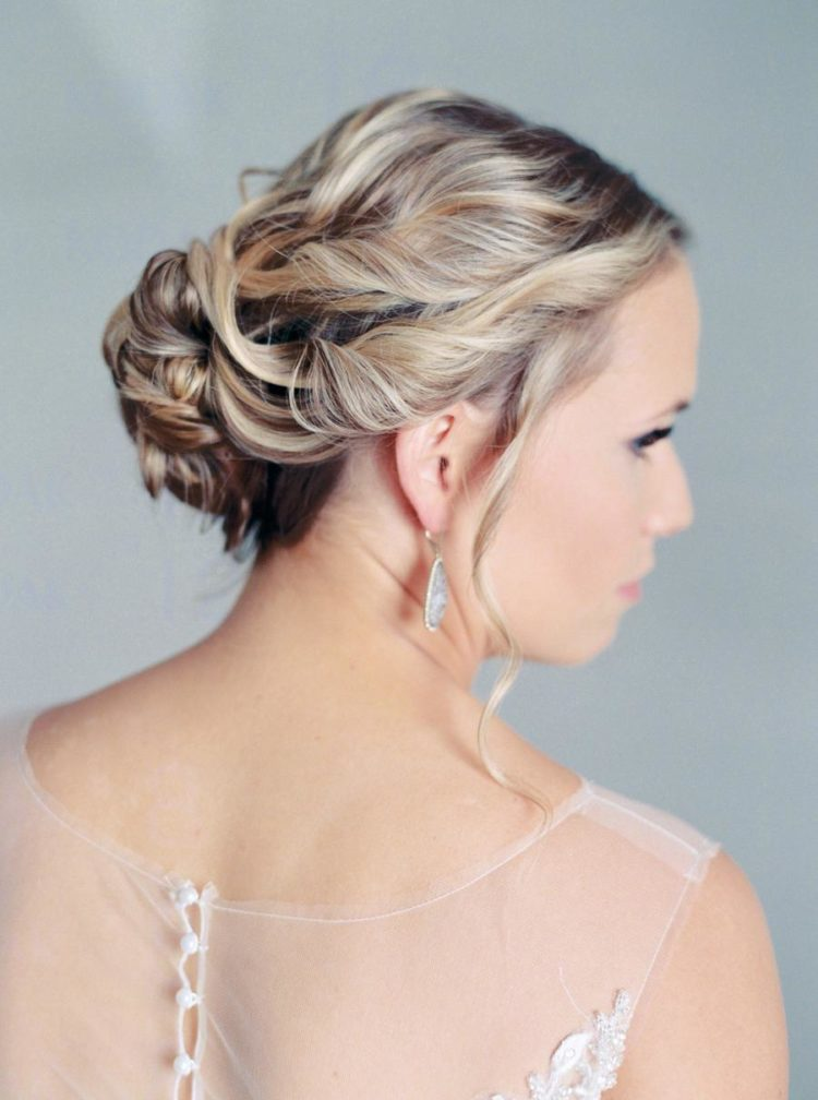 She was rocking a beautiful wavy updo with some locks down and statement earrings