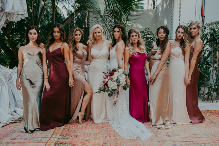 The bridesmaids were rocking mismatching silk slip dresses - every gilr chose what she likes