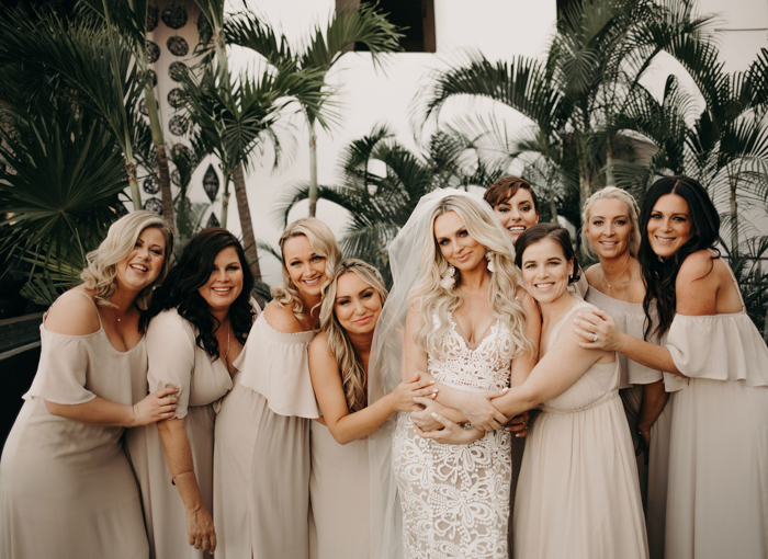 The bridesmaids were wearign neutral mismatching dresses