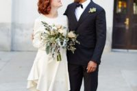 05 a casual plain knee wedding dress with a high neckline, long sleeves and an asymmetrical skirt plus white shoes