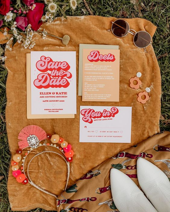 a fun and colorful wedding invitation suite done with bold letters and in muted colors for a mid-century or 70s wedding