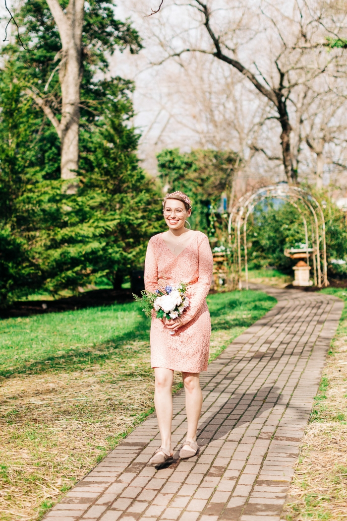The bride was wearing taupe suede bow flat shoes to finish off her look