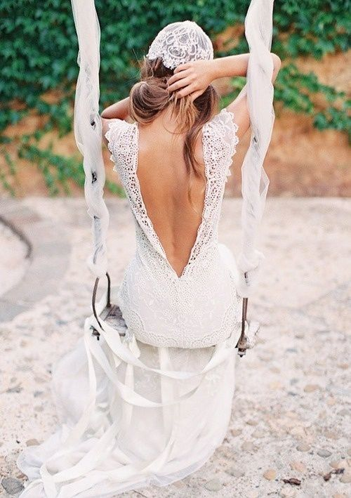 a boho lace wedding dress with a low cutout back, no sleeves and a cap veil for a cool matching look