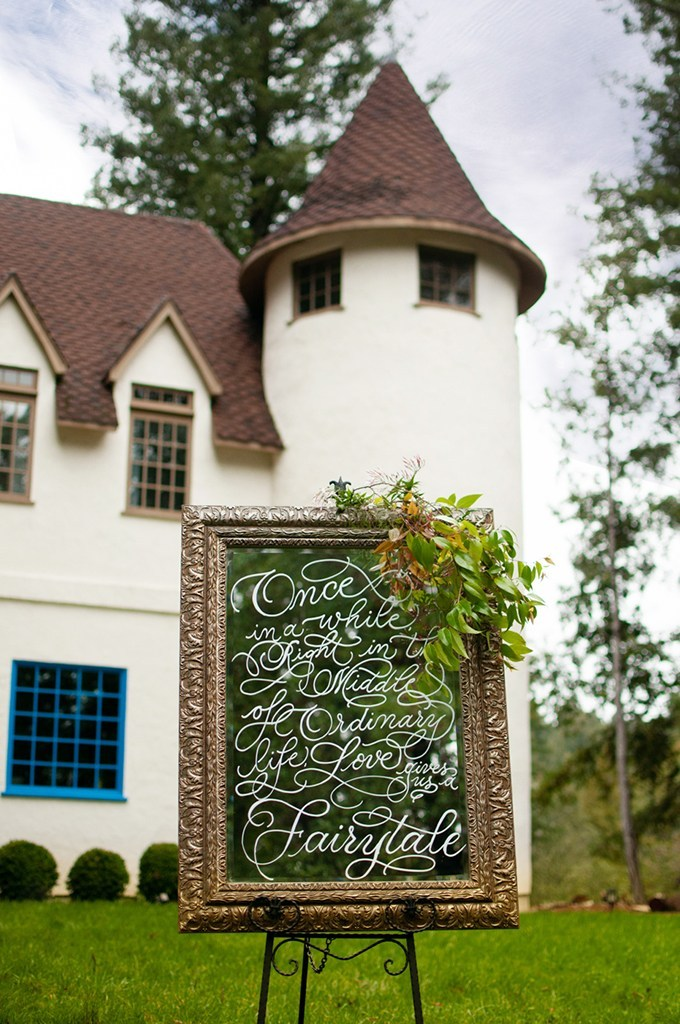 The house reminded of a castle and looked very elegant, and the wedidng sign was made of a framed mirror with greenery