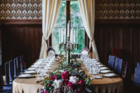 07 The reception space was really royal, with lavish blooms cascading down from the table, gorgeous candelabras and a statement chandelier