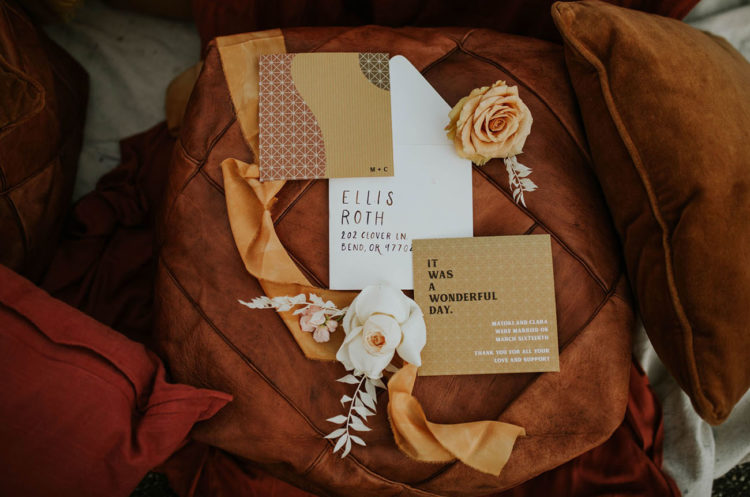 a chic 70s inspired wedding invitation suite done in gold, brown and with patterns