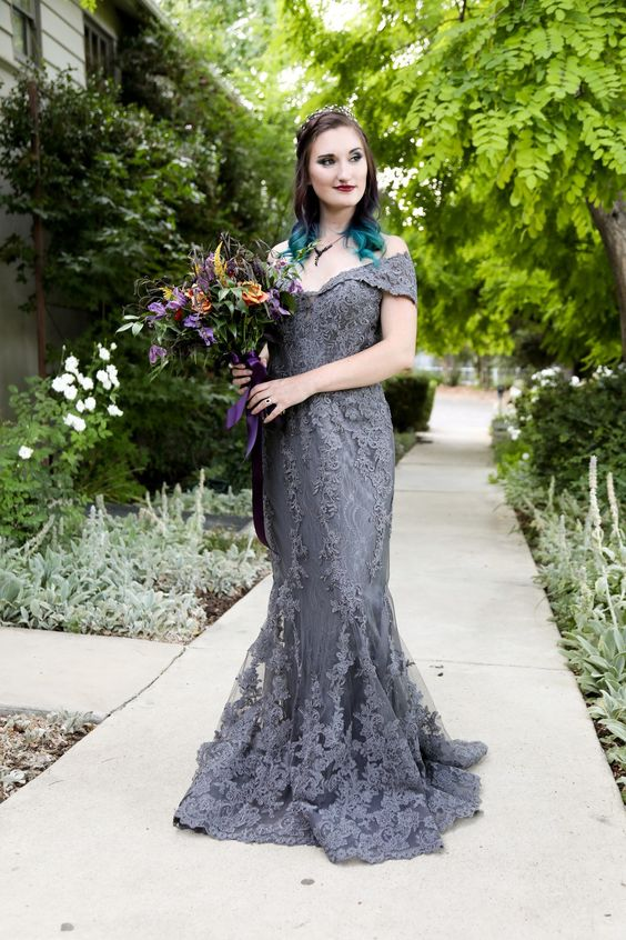 a graphite grey mermaid wedding dress with an off the shoulder neckline for a modern Gothic bride