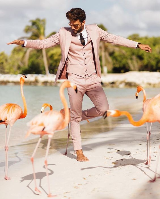 a pink three-piece froom's suit is a creative solution for a tropical beach wedding