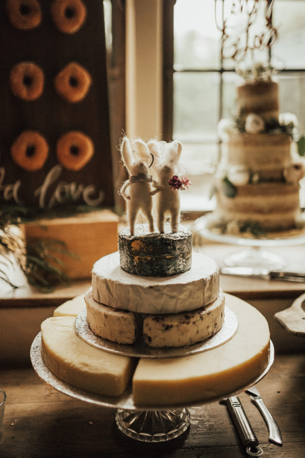 A usual wedding cake was substituted with a cheese tower and funny mice toppers