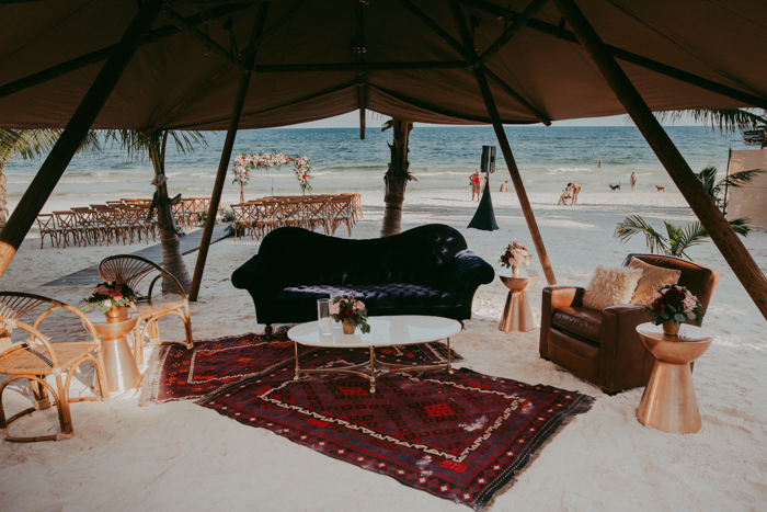 The beach lounge was done with rattan chairs, a leather one, a velvet sofa placed right on the sand
