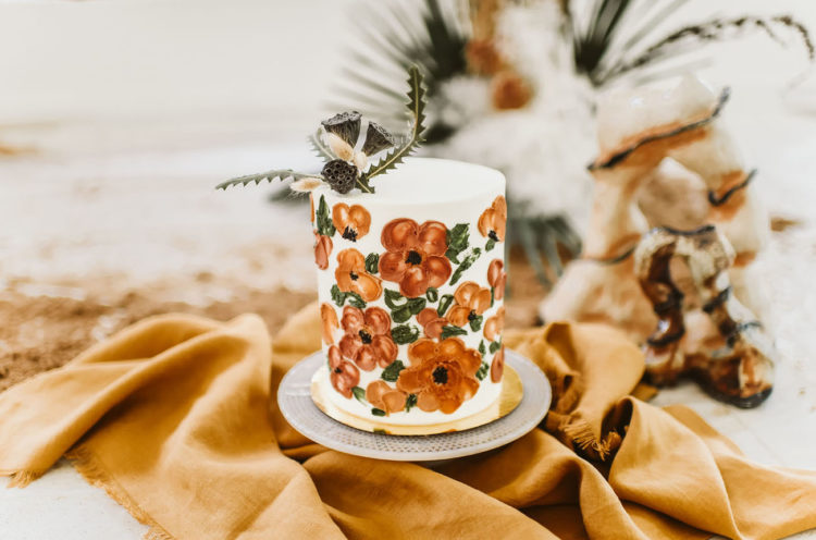 The wedding cake was decorated with terra cotta flowers painted on it