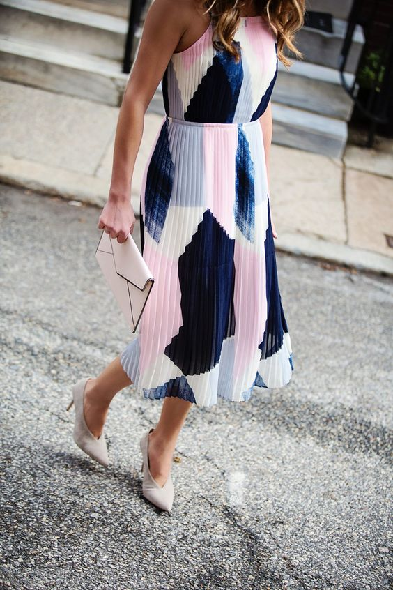 a navy, white and pink color block print midi pleated dress with spaghetti straps, a blush cltuch and white shoes