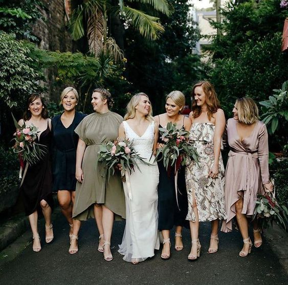 casual mismatching midi dresses in various colors and fabrics will make your bridal party happy as they can choose what they really like