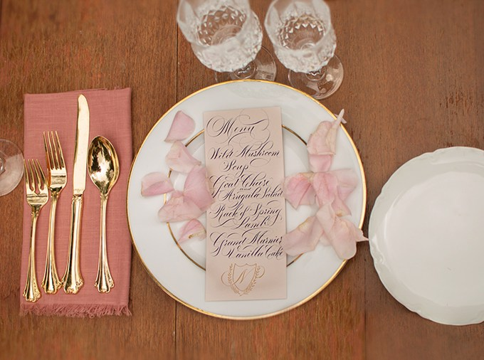 Pink petals, refined calligraphy and chic crystal glasses helped to create an ambience