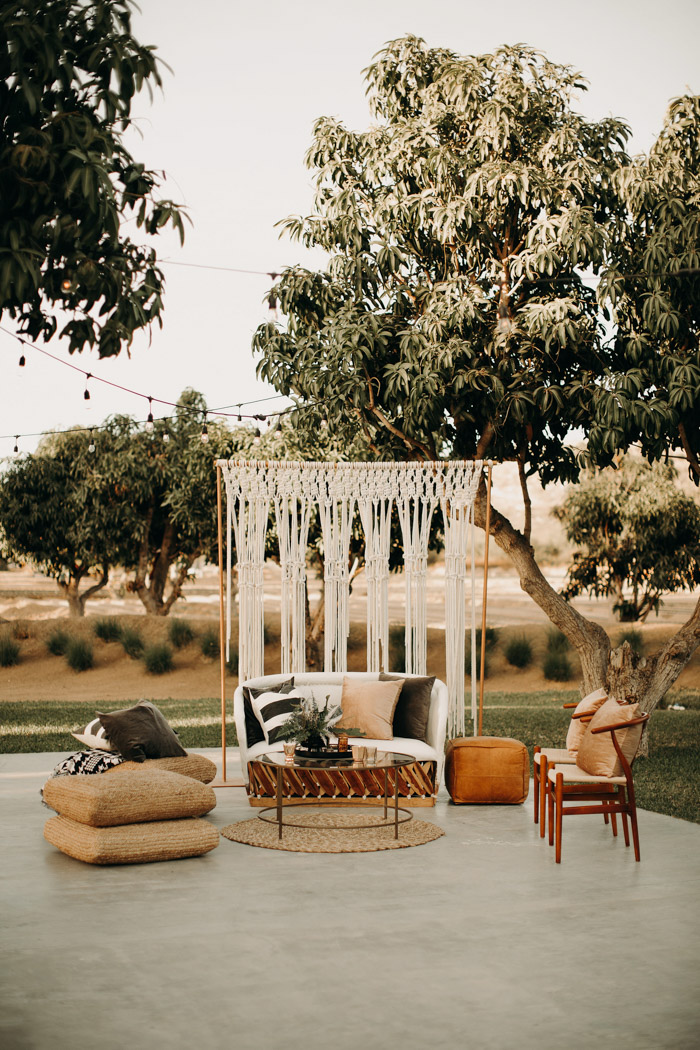 The wedding lounge was done with jute rugs and ottomans, a macrame backdrop plus chairs