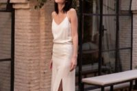 10 a white silk slip wedding dress with a side slit and vintage-inspired sparkling shoes for a casual bride