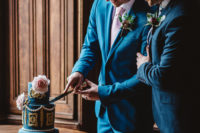11 The wedding cake was bright blue, with gold and white decor plus beautiful pink roses