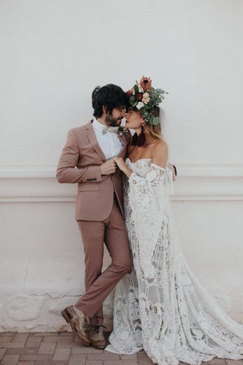 a chic mauve wedding suit, a white shirt, a creamy bow tie, shabby brown shoes with no socks for a boho wedding
