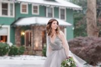 13 a grey wedding dress with a layered tulle skirt, an embroidered bodice and a sheer coverup with long sleeves