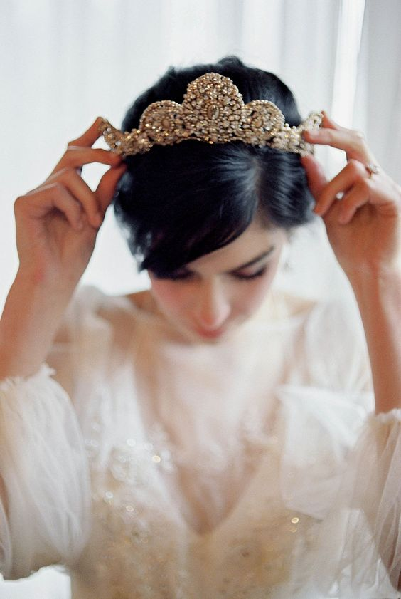 a heavily embellished bridal tiara will make a bold statement, you won't need other accessories