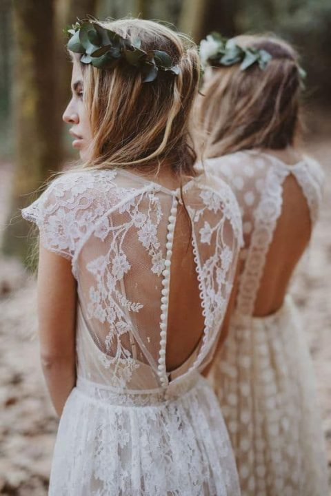 a lace wedding gown with cap sleeeves and an illusion back on buttons that you may unbutton tp show off some skin