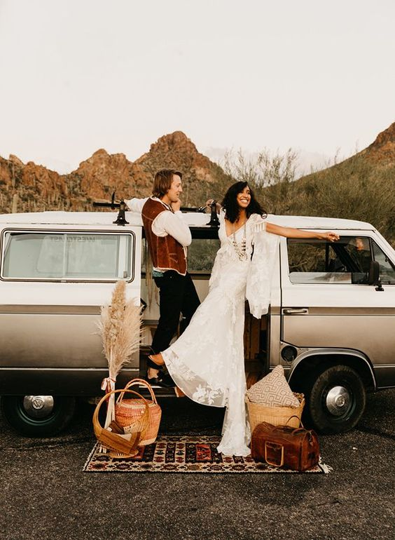 a boho lace wedding dress with bell sleeves, fringe and a train for a 70s inspired boho bridal look