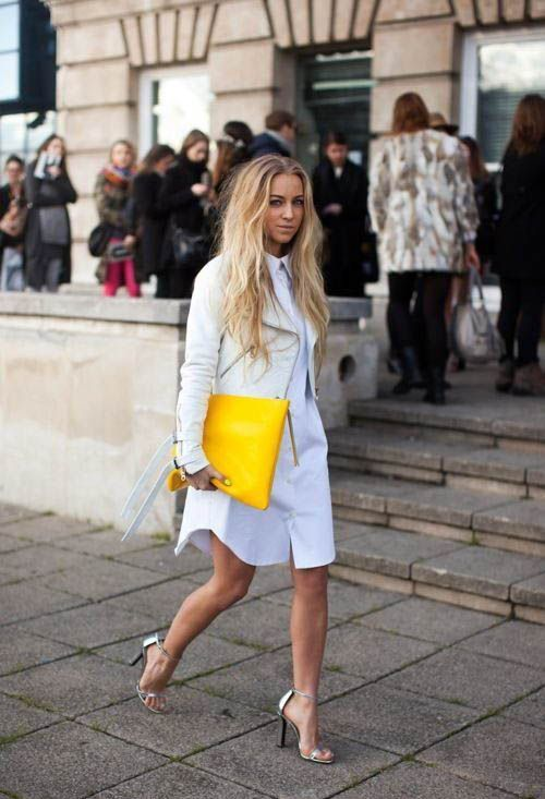 a white shirtdress, a white leather jacket, metallic heels and a sunny yellow clutch for a modern wedding