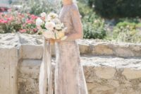 14 an embellished grey lace A-line wedding dress with a high neckline, long sleeves and a train for a glam bride