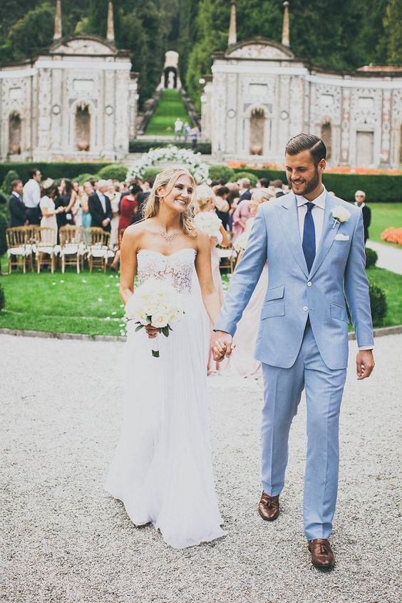 a chic light blue suit, a white shirt and a navy tie plus brown moccasins for a formal summer groom's look