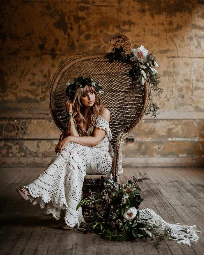 a cold shoulder full crochet mermaid wedding dress with platform shoes and a floral crown for a truly boho look