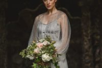 15 a vintage-inspired grey silk wedding dress wtih an embellished skirt and an embellished cape with long sleeves