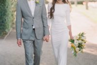 16 a casual plain sheath wedding dress with a high neckline, long sleeves and neutral heels to finish off the look