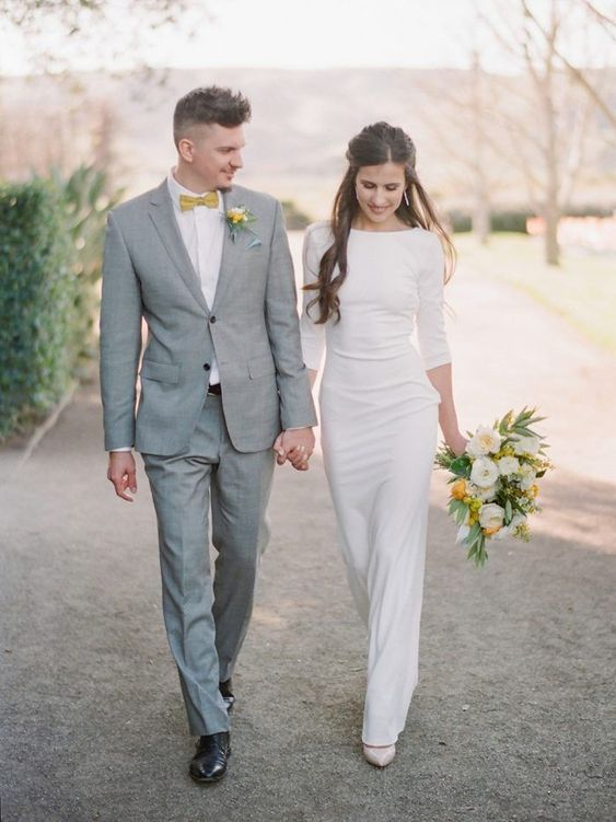 a casual plain sheath wedding dress with a high neckline, long sleeves and neutral heels to finish off the look