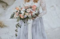 18 a beautiful wedding outfit with a white lace top with long sleeves and a grey marble skirt  for a trendy look
