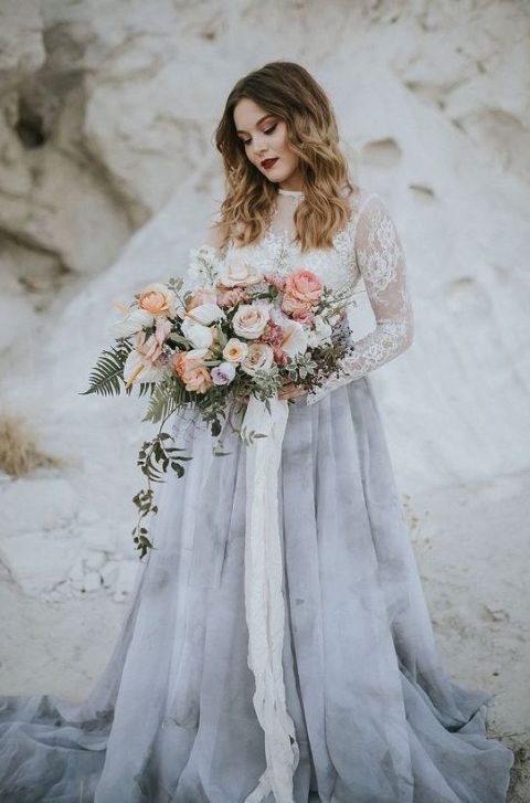 a beautiful wedding outfit with a white lace top with long sleeves and a grey marble skirt  for a trendy look