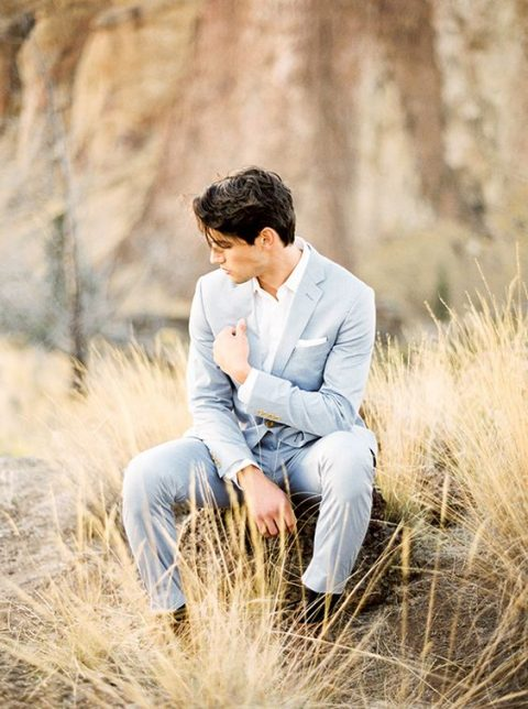 a light blue suit, a white shirt and no tie for a more relaxed look will fit many wedding seasons and themes