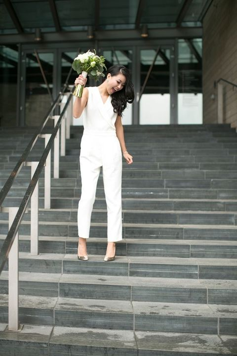 a casual white bridal jumpsuit with no sleeves and a V-neckline plus metallic shoes for a modern bride