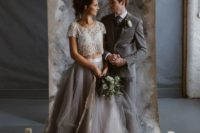20 a glam bridal separate with an embellished cropped bodice and a layered graphite grey skirt
