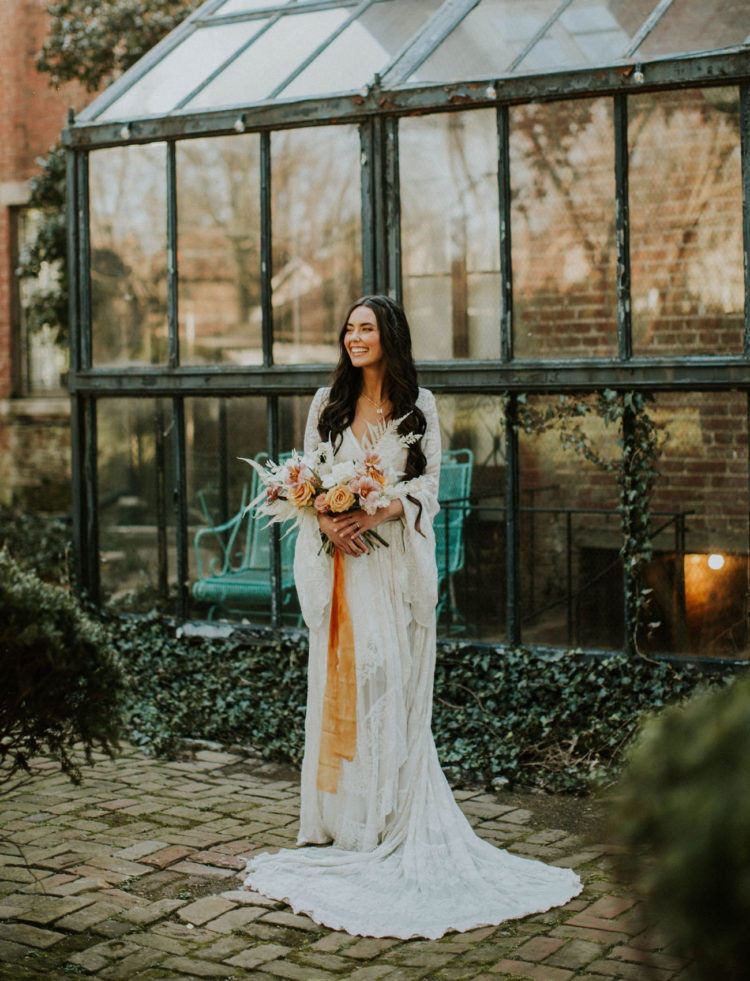 a lace wedding gown with bell sleeves and a V-neckline plus a train is a great idea for a 70s boho bridal look