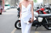 21 a minimalist jumpsuit with spaghetti straps and wide leg pants is an ideal option for a casual bride, just add accessories
