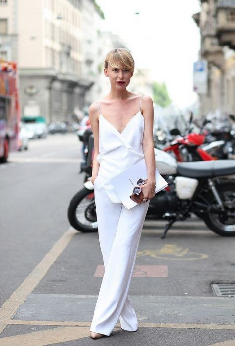 a minimalist jumpsuit with spaghetti straps and wide leg pants is an ideal option for a casual bride, just add accessories